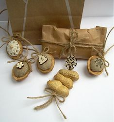 Nuts christmas presents decoration Holiday Ornaments, Christmas Presents, Christmas Holidays, Xmas, Christmas Present Decoration, Christmas Decorations, Walnut Shell Crafts, Craft Fairs, Gift Wrapping