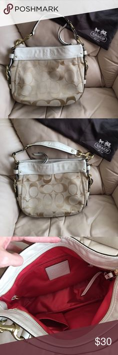 Coach purse Gold and tan in color, red inside. Gold hardware. Some signs of wear on bottom as shown in picture. Comes with dust bag! Zipper closure. Coach Bags Shoulder Bags
