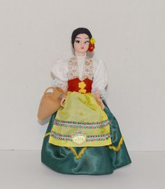 "This beautiful doll wears the costume unique to the Puglia region. Made in Italy with authentic details, this doll in her beautiful outfit stands 10"" tall, the perfect size to proudly display. A collector's item, not a toy. Clothing cannot be removed. Doll comes packaged in an attractive, clear cover box, marked ""Made in Italy"" suitable for age 5+ Beautiful Dolls, Beautiful Outfits, Italy Country, Clothespin Dolls, Collector Dolls, Covered Boxes, Detail, Unique, How To Make"