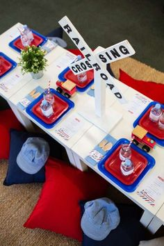 Don't miss this fun train-themed birthday party! The table settings are so cute! See more party ideas and share yours at CatchMyParty.com #catchmypartyideas #trains #trainparty #boybirthdayparty #tablesettings