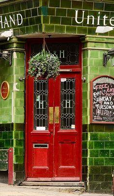 Cherry red door. - Brighton, East Sussex, England