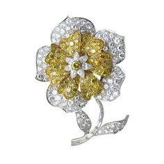 Van Cleef & Apels. Center of the brooch has one natural yellow brilliant surrounded with a cluster of 7 pear shape diamonds. The stem of the brooch is encrusted with baguette shape diamonds,  Estimated total weight of natural fancy yellow & white diamonds is 19 carats. Platinum & 18k gold Signed: Van Cleef & Arpels N.Y. # 41577