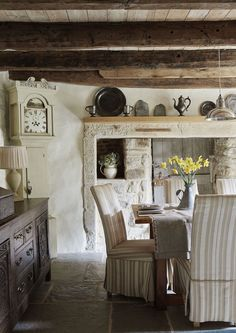 Stone wall in an ancient home in the north east of England, the living room