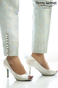 Blue jamavaar cigarette trousers with pearl buttons on sides. Plazzo Pants, Salwar Pants, Trouser Pants, Harem Pants, Cigarette Trousers, Cigarette Pants Pakistani, Salwar Designs, Blouse Designs, Pants For Women