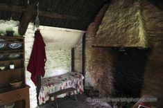 http://freeirishphotos.com/images/large/cottages/interior/old_cottage_interior_4.jpg. Love that little drapery over the tiny bed.