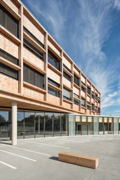 The College in Lamballe is mainly constructed in timber. It consists of two separate buildings: a long rectilinear parallelepiped rests on a gently curved base, to echo the site's topography and fit in with the landscape. Fully glazed, the ground floor brings a sense of lightness to the building. #architecture #education #school #building #glass #timber #france Simone Veil, School Building, Building Architecture, Ground Floor, Separate, Buildings, Multi Story Building, College, Construction