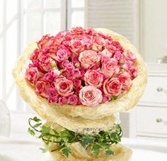 Blooming Precious... Thirty pieces perfect sweet pink roses and 5 stem pink spray roses make a beautiful gift for the lovely lady in your life. She's sure to cherish this bouquet of sweet pink roses accented with pink spray roses wrapped with special wrapping paper. Please call us for details on ordering this arrangement in another color such as red, peach, orange, white, yellow, purple, and fuchsia pink.