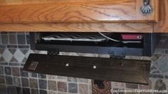 DIY Under-the-Cabinet Docking Station | Confessions of a Serial Do-it-Yourselfer Maybe use as extra key storage also?