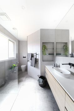 Neutral tones paired with matte black accessories for this ensuite renovation by our clever design team. Mold In Bathroom, Zen Bathroom, Neutral Bathroom, Bathroom Renos, Small Bathroom, Parisian Bathroom, Bathroom Inspo, Washroom, Bathroom Cabinets