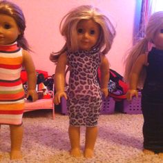 Doll dresses made out of tights! Maggie saw the idea in her American Girl magazine...cuteness!