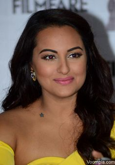 Gorgeous! In a strapless dress, Sonakshi Sinha shows off the star tattoo on the side of her neck and just above her right shoulder lines. via Voompla.com