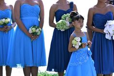 Love the blue one strap dress behind the flower girl...   Found on Weddingbee.com Share your inspiration today!