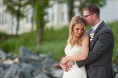 Groom hugging Bride on the beach. Kent Island Maryland Chesapeake Bay Beach Club wedding ceremony and getting ready photo, by wedding photographers of Leo Dj Photography. http://leodjphoto.com