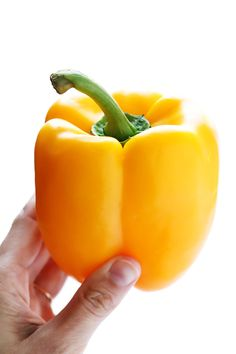 """Learn how to cut a bell pepper 4 ways (diced, sliced, ringed, or hollowed-out to be """"stuffed"""") with this easy 1-minute video tutorial!"""