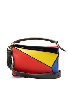 Loewe updates its cult leather Puzzle bag with Resort 2017's eye-popping colour palette in mind. Clashing paintbox hues enhance the hallmark malleable panels that can be folded like origami and fall completely flat when empty. It's perfect for bringing energy to pared-back off-duty ensembles.
