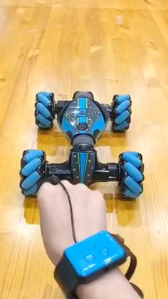 GESTURE SENSING STUNT REMOTE CONTROL CAR This omnidirectional movement is based on the principle of a central wheel with a number of axles located around the wheel that converts part of the wheel steering force to a wheel normal force.