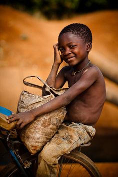 Africa |  Young boy photographed in Burkina Faso by Eric Montfort
