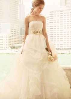 remembertheromance:    Vera Wang created affordable gowns for brides shopping at Davids Bridal. This is one of my favourites. I love the lace top and the gorgeous tulle skirt. The floral belt pulls into a bow in the back and adds the perfect feminine touch to this stunning gown.