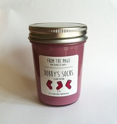 Can't think of a reason not to buy it....  Dobby's Socks Soy Candle  8 oz by FromthePage on Etsy, $10.00
