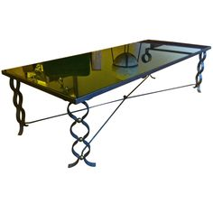 JEAN ROYÈRE long coffee table in wrought iron model ruban with brass balls