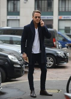 Choose a black overcoat and black skinny jeans for a seriously stylish look. Feeling inventive? Complement your outfit with black leather chelsea boots. Shop this look on Lookastic: https://lookastic.com/men/looks/overcoat-crew-neck-t-shirt-skinny-jeans/16190 — Black Overcoat — White Crew-neck T-shirt — Silver Watch — Black Skinny Jeans — Black Leather Chelsea Boots