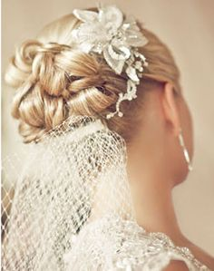 Beautiful Traditional Wedding Updo with White Flower and Veil