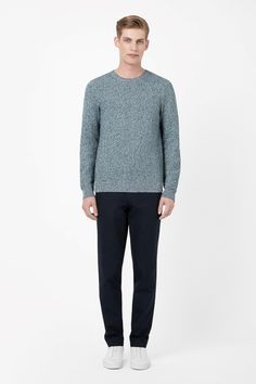 Knitted from mixed yarns for a tonal melange effect, this round-neck jumper is made from a blend of linen and cotton. Designed for comfortable everyday wear, it is a regular relaxed fit with classic ribbed edges.