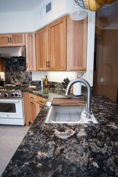 Dark granite countertops still show up in remodels from time to time