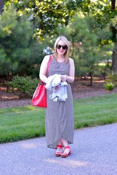 Stripe dress with red accessories.