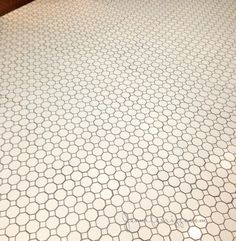 White cermic tile with warm grey grout