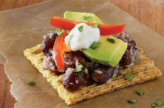 Spring into action on a sunny day with TRISCUIT Hint of Salt Crackers and this Black Bean Hummus Topper creation.