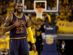 News Photo : LeBron James of the Cleveland Cavaliers reacts in...