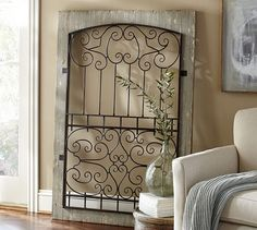 I've had one on my wall for years! Looking to re-hang on the distressed wood in a new location!   Window Gate | Pottery Barn