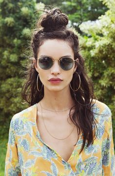 The messy top knot was made for summer. The more wild, dirty, and imperfect your hair is, the better the whole style looks, so you don't have to worry about humidity, frizz, or flyaways.