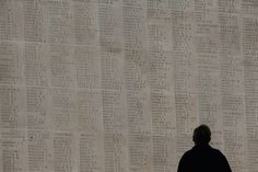 A man looks at the names of the missing on the Thiepval Memorial in Arras, France, on November 4, 2008. The Commonwealth War Grave Commission manages 956 cemeteries in Belguim and France, which bear witness to the heavy human sacrifice made on the Western Front during the First World War (1914-1918) and Second World War (1939-1945).