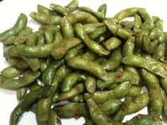 """""""Freaky Edamame"""" ~ Tried to make it like Mikuni and this was as close as I could get. Heat 1-2T sesame oil over med-high heat. Add edamame (fresh, not frozen, ends snipped) stir fry 2-3 min. Lower heat to med, add 2 cloves minced garlic and 2-3 pinches of sea salt and cayenne pepper. Stir fry another 2-3 min. Serve warm. Spicy and YUMMY!"""