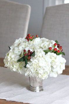 Beautiful hydrangea and holly berry centerpiece for a winter bridal shower.