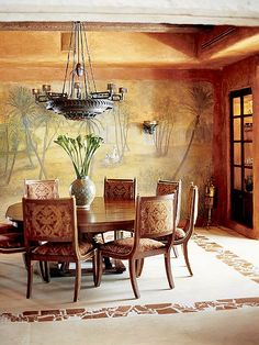 Marrakech Expressed - Dining room with desert mural on back wall.