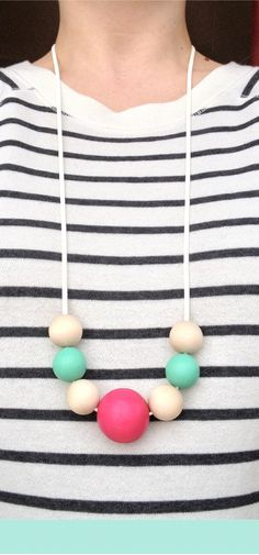 Hot pink, teal and natural wood necklace made by me to wear with my striped sweatshirt
