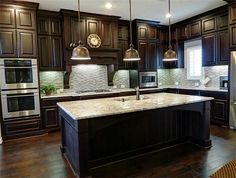 Wood flooring in kitchen, dark cabinets.. I wasn't sure about my kitchen cabinets with dark wood floors too, but this is pretty!