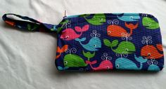 Hand made Large Wristlet with blue whale print and pink zipper and turquoise interior lining - gifts under 20 - nautical accessories. $12.00, via Etsy.