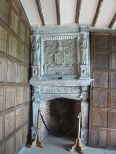 Little Moreton Hall, also known as Old Moreton Hall, is a moated half-timbered manor house 4 miles southwest of Congleton in Cheshire, England.  In #MainsHall manor we found a fireplace in a similar position off to one side of the room with beautiful paintings on the wall.