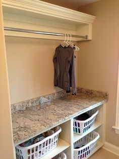 Basket shelves for laundry. See other pictures for backsplash and cabinet color ideas.