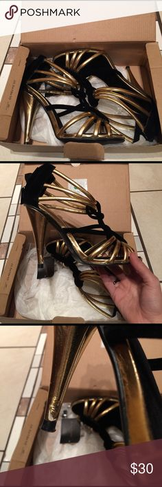 Zara heels Used and in good condition Zara black and gold heels. Heels do have a few marks but in good working condition. Comes with replacement heel bottoms Zara Shoes