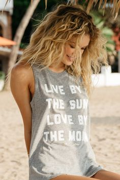 """- Live and love in our best-selling muscle tank featuring one of our favorite daily reminders. - Made from a luxurious supima cotton / modal jersey blend. - Model is 5'8"""" and wearing size small. SP704"""