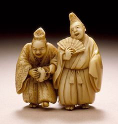 Meikeisai Hojitsu (Japan, died 1872) Entertainers, mid-19th century Netsuke, Ivory with staining, sumi