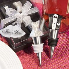 Bride/Groom Wine Stopper Set-Each set contains two 4 x 1 x 1 stoppers with sturdy metal bases wrapped with a black or white rubber gasket. Topping the groom stopper is a handsome resin tux ensemble, with a sparkle and rhinestone enhanced resin gow Wine Wedding Favors, Unique Wedding Favors, Bridal Shower Favors, Unique Weddings, Wedding Gifts, Wedding Ideas, Wedding Stuff, Dream Wedding, Wedding Planning