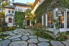 Built in 1991, the home has a feel that's part Hamptons, part France. This is the entry courtyard. Off to the left is a fountain.