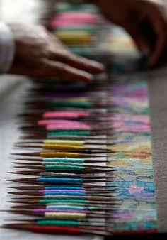 Weaving a Kani shawl.