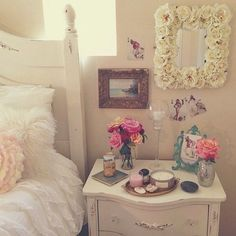Love this set up. Especially the frames placed slightly above the night stand